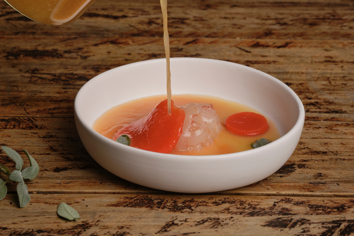 Raviole de homard et tomate en gelée